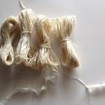 Four sizes of spun thread